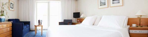 """La habitación en la que nos hospedamos, """"Familia Exterior Lujo con Terraza""""."""